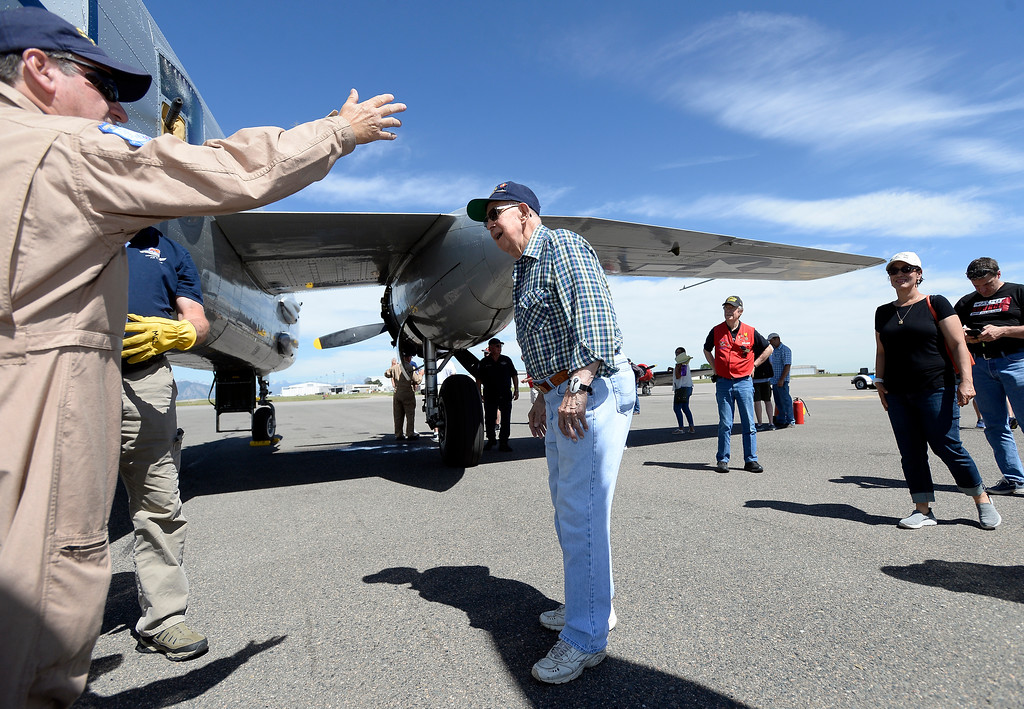 . WWII Navy veteran Bob Seeber, at center, prepares to board a WWII era B-25J Bomber before going for a ride in the aircraft on Friday at the Rocky Mountain Metropolitan Airport in Broomfield. For more photos of the airplane go to dailycamera.com Jeremy Papasso/ Staff Photographer 06/08/2018
