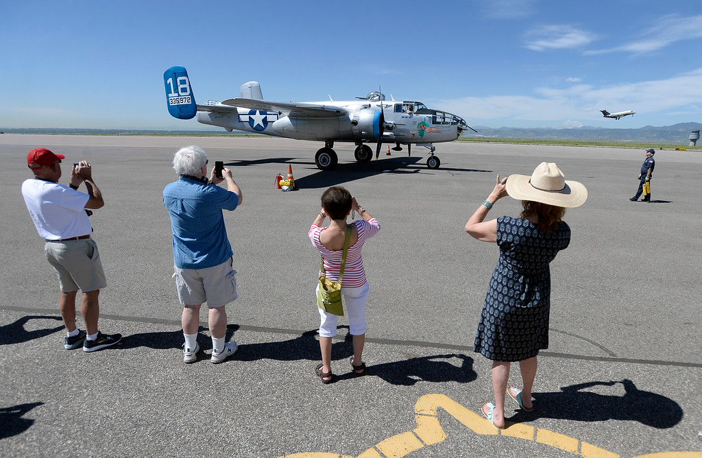 . Spectators watch as a WWII era B-25J Bomber arrives after giving a WWII veteran a ride on Friday at the Rocky Mountain Metropolitan Airport in Broomfield. For more photos of the airplane go to dailycamera.com Jeremy Papasso/ Staff Photographer 06/08/2018