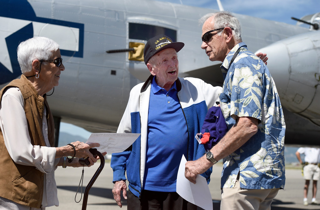 . WWII Navy veteran Frank Smith, center, talks with Army veteran Jim Dries after going for a ride in a WWII era B-25J Bomber on Friday at the Rocky Mountain Metropolitan Airport in Broomfield. For more photos of the airplane go to dailycamera.com Jeremy Papasso/ Staff Photographer 06/08/2018