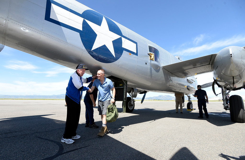 . WWII Navy veteran Frank Smith, of Broomfield, left, shakes hands with Air Force veteran Andrew Barnhorst after both men took a ride in a WWII era B-25J Bomber after going for a ride in the aircraft on Friday at the Rocky Mountain Metropolitan Airport in Broomfield. For more photos of the airplane go to dailycamera.com Jeremy Papasso/ Staff Photographer 06/08/2018