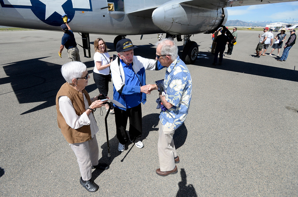. WWII Navy veteran Frank Smith, of Broomfield, at center, his wife Fran Smith, left, and Jim Dries, of Evergreen, at right, talk with each other after going for a ride in a WWII era B-25J Bomber after going for a ride in the aircraft on Friday at the Rocky Mountain Metropolitan Airport in Broomfield. For more photos of the airplane go to dailycamera.com Jeremy Papasso/ Staff Photographer 06/08/2018