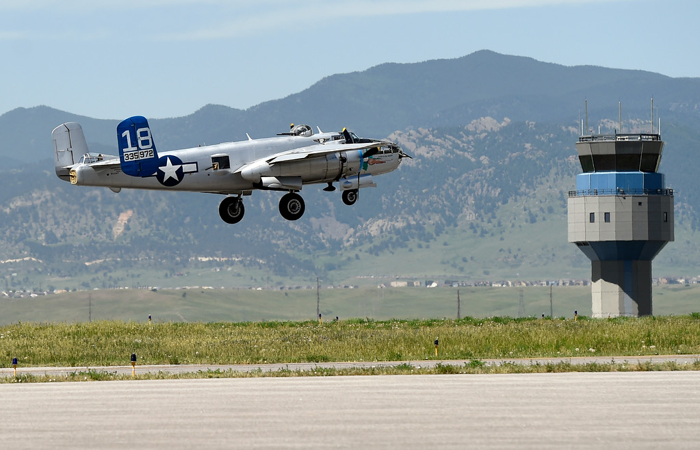 . A WWII era B-25J Bomber leaves the runway while taking people for a ride in the aircraft on Friday at the Rocky Mountain Metropolitan Airport in Broomfield. For more photos of the airplane go to dailycamera.com Jeremy Papasso/ Staff Photographer 06/08/2018