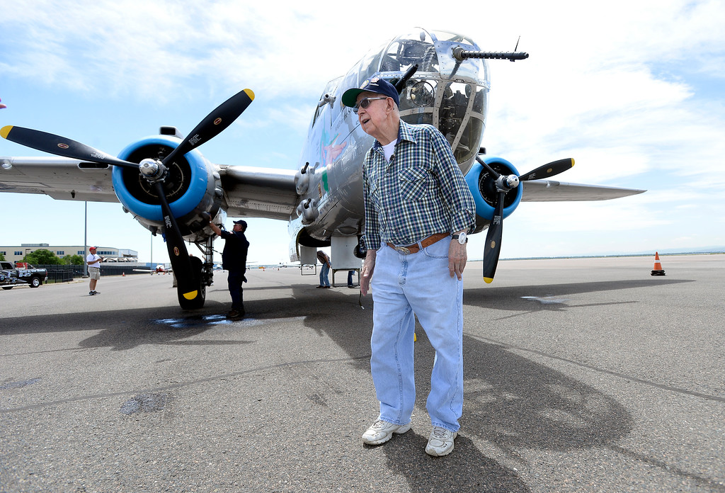 . WWII Navy veteran Bob Seeber, of Broomfield, walks past a WWII era B-25J Bomber after going for a ride in the aircraft on Friday at the Rocky Mountain Metropolitan Airport in Broomfield. For more photos of the airplane go to dailycamera.com Jeremy Papasso/ Staff Photographer 06/08/2018