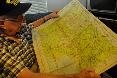 Les is looking at an old AAF flight map of India.