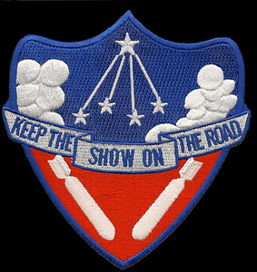 "Unit patch of the 384th Bombardment Group, ""KEEP THE SHOW ON THE ROAD"" Sheldon stated that a pilot from the 348th had been shot down and taken prisoner of war.  The captured pilot sent the unit a postcard which the German censors did not catch.  The phrase ""KEEP THE SHOW ON THE ROAD"" became their motto."