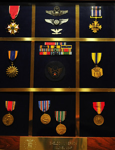 USAF Decorations; Distinguished Flying Cross, 2 Unit Citations, European-Middle Easter-African Campaign for his service with the 384th B.G.