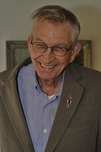 Arthur Janson today proudly wears the Purple Heart on his lapel.