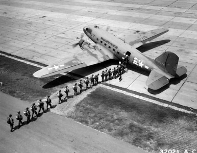 Lawson Field, Fort Benning, Georgia, August 1946....At the command of their jump leader these twenty-one students of the Airborne School climb aboard a waiting Douglas C-47 of the 75th Troop Carrier Squadron which will take them up for a practice jump.  After losing its cargo the plane will return quickly and pick up another load of jumpers without waiting long enough to turn off its motor.