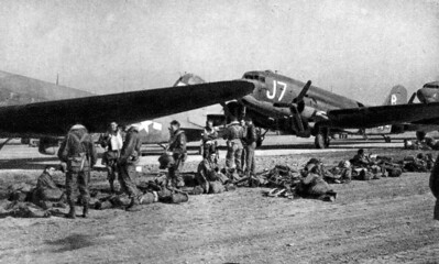 Members of the 303rd Troop Carrier Squadron, 442nd Troop Carrier Group, prepare to launch C-47 aircraft to carry American soldiers across the Rhine River into Germany during World War II.  Part of the job of the wing historian is to preserve documents and photos to remember events in a unit's history such as this momentous occassion.