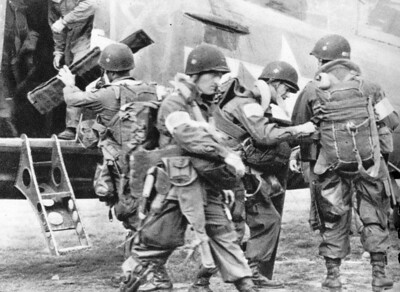 "82nd Airborne members check their equipment before boarding a 442nd Troop Carrier Group C-47 bound for Drop Zone ""T"" near St. Mere Eglise in Normandy on D-Day, June 6, 1944. The 442nd Troop Carrier Group launched 45 C-47s with approximately 20 soldiers in each aircraft. The 442nd TCG was the World War II predecessor of the 442nd Fighter Wing, an Air Force Reserve Command A-10 Thunderbolt II unit based at Whiteman Air Force Base, Mo. (Photo courtesy of the Herky Barbour estate)"