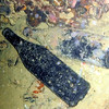 Sake bottles retrieved from the wreck and displayed for divers on its deck.