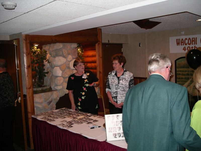 Sharon DeVore & Diana Scott staff the reception table as Fred and Laura Martens Sweetland arrive.