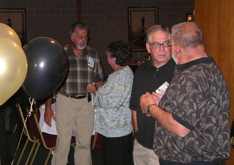 Craig Tiezzi, Linn Plummer, Jim Rollings, and Gary Lucas ('57)