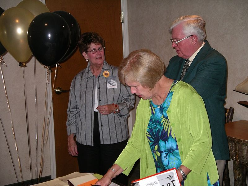 Chris Wilhelm greets Fred and Laura Martens Sweetland.