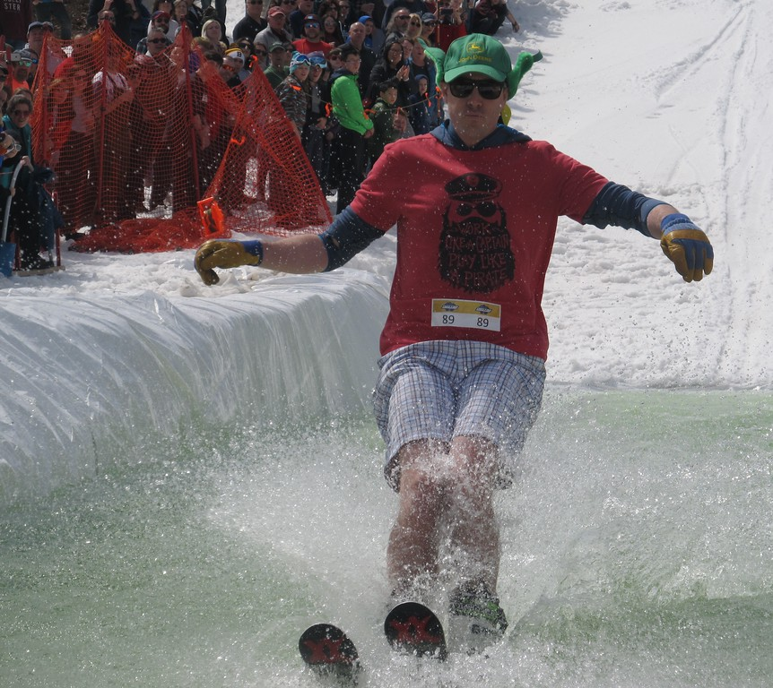 . VJ Donnelly of Westboro successfully skis across the water during Wachusett Mountain\'s Pond Skim Festival on Sunday. SENTINEL & ENTERPRISE / Nick Mallard