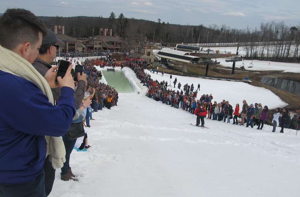 . Spectators take in the action during Wachusett Mountain\'s Pond Skim Festival on Sunday. SENTINEL & ENTERPRISE / Nick Mallard