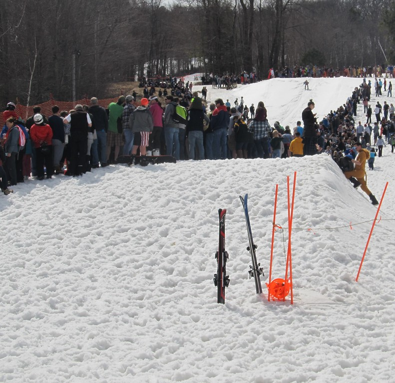. Spectators line a slope during Wachusett Mountain\'s Pond Skim Festival on Sunday. SENTINEL & ENTERPRISE / Nick Mallard