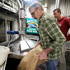 Brew Master David Howard from Wachusett Brewing Company put some wheat flakes into the mash cooker at the Wachusett brewing Company to start the process for making the beer they are calling Worcester's Bravest. Wachusett and Wormtown Brewery have come together to make this beer to help raise money to be donated to the Ava Roy Fund set up by the Worcester International Association of Firefighters local 1009. Just behind Howard is Brew Master Ben Roesch of Wormtown. SENTINEL & ENTERPRISE/JOHN LOVE