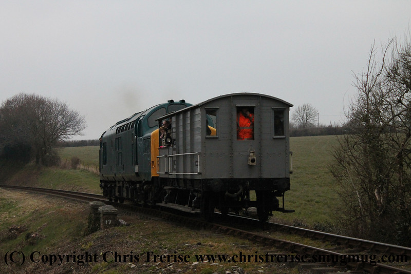 Class 37 Diesel Locomotive number 37 142 between Bodmin General and Boscarne Junction with GWR Toad Brake Van number W35302.<br /> 9th April 2013