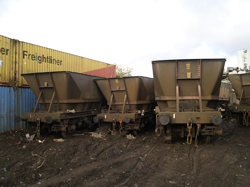 Ex MGR hoppers over the far side of Booths yard. 353875 on the left is seen with 2 others on 06/11/10