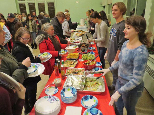 PHOTOS BY JENN SMITH — THE BERKSHIRE EAGLE <br /> Members of the Wahconah Regional High School National Honor Society serve guests to their fourth annual 'Empty Bowls Dinner,' held Sunday evening at the Dalton United Methodist Church. Guests were able to fill up with hearty fare provided by the students and their families, but went home with an empty handmade ceramic bowl to remind them that many people in the community don't have enough to eat.