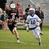 GEOFF SMITH — THE BERKSHIRE EAGLE<br /> Wahconah attackman Matt Mathers carries the ball up the field as Belchertown's Jack Fillippelli runs alongside him during a Central/Western Massachusetts Division III tournament game in Dalton on Monday.