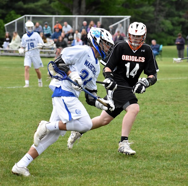 GEOFF SMITH — THE BERKSHIRE EAGLE<br /> Wahconah's Tim Clayton brings the ball up the field as Belchertown's Matt Pacheco defends him during a Central/Western Massachusetts Division III tournament game in Dalton on Tuesday.