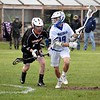 GEOFF SMITH — THE BERKSHIRE EAGLE<br /> Wahconah's Jeremy Girard looks for a teammate to pass to as Belchertown's Grant Irving defends him during a Central/Western Massachusetts Division III tournament game in Dalton. Girard had five goals and added three assists in a 15-5 win.