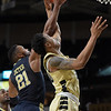 John Collins fights for rebound