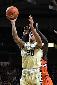 John Collins shot off rebound