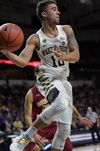 Mitchell Wilbekin looks to pass under basket 02