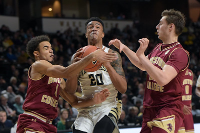 John Collins double teamed