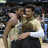 Aaron Rountree and Devin Thomas celebrate with fan