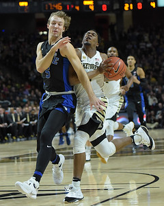 Bryant Crawford fouled by L Kennard