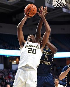 Terrence Thompson shot under basket after rebound