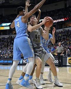Dinso Mitoglou shot under basket
