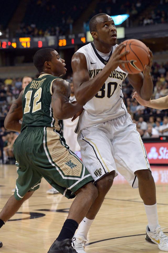 Travis McKie rebound & shot