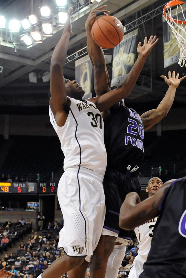 Travis McKie fights for rebound
