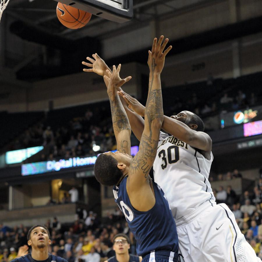 Travis McKie shot under basket