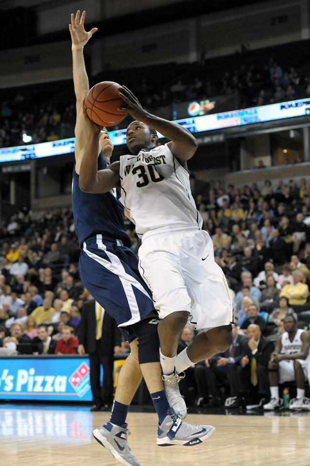 Travis McKie shot under basket 02