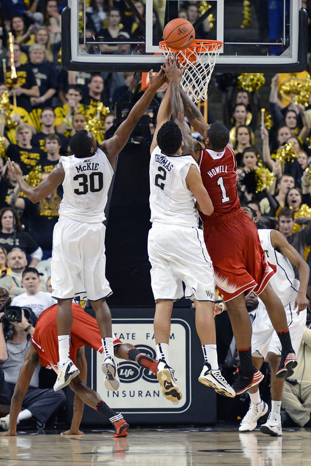 Devin Thomas and Travis McKie fight Howell for rebound