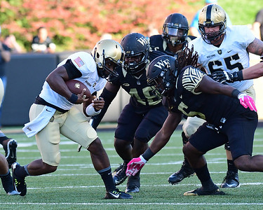 Jaboree Williams and Willie Yarbary tackle A Bradshaw