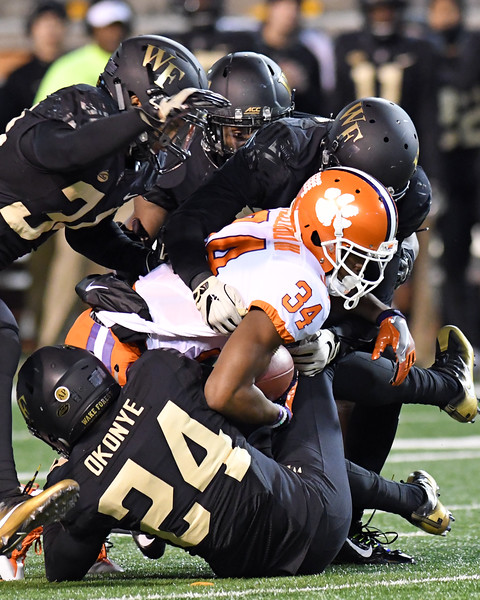 Josh Okonye and defense tackle R McCloud