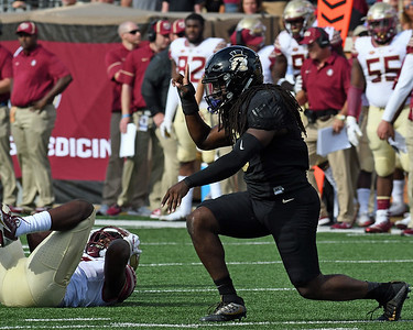 Jaboree Williams celebrates tackle for loss of J Patrick