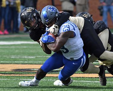 Demetrius Kemp tackles S Wilson