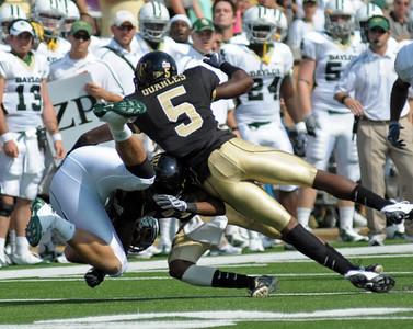 C Quarles and M Williams tackle