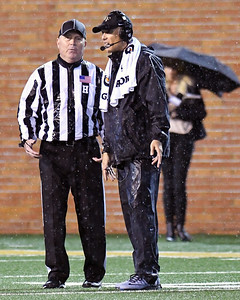 Coach Clawson confers with referee