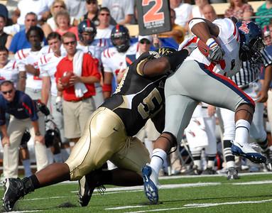 Carter tackles Davis