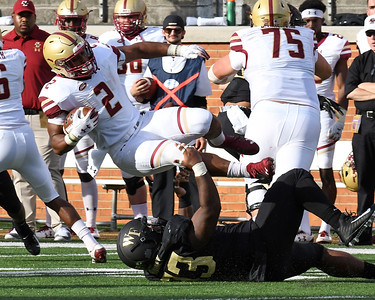 Zeek Rodney tackles AJ Dillon
