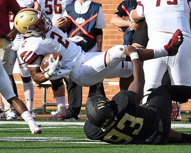 Zeek Rodney tackles AJ Dillon 02